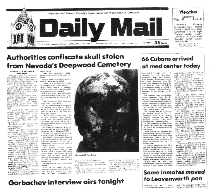 Newspaper clipping featuring a picture of a skull.