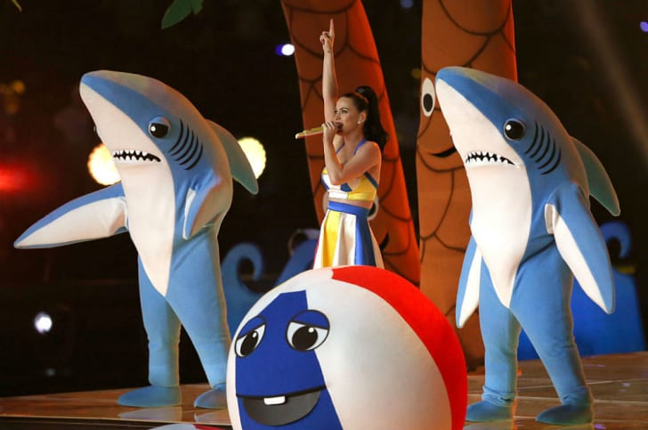 Singer Katy Perry appears on stage with two dancing sharks