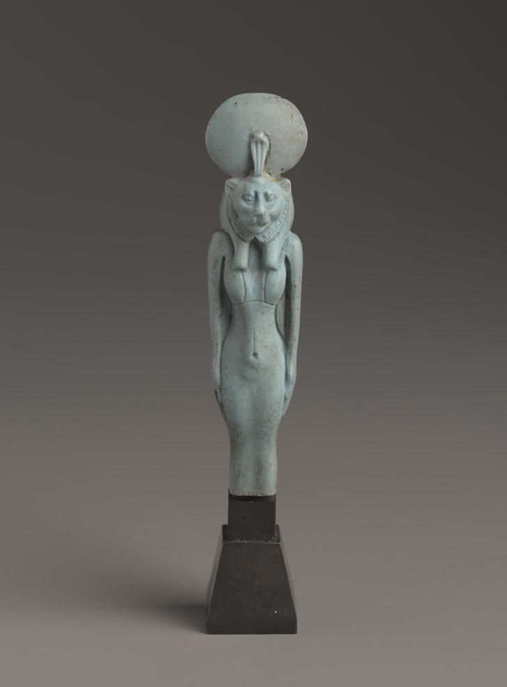 An ancient Egyptian figurine of a standing lion-headed goddess, on display at the Smithsonian's Arthur M. Sackler Gallery.