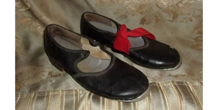 A pair of black leather girl's shoes