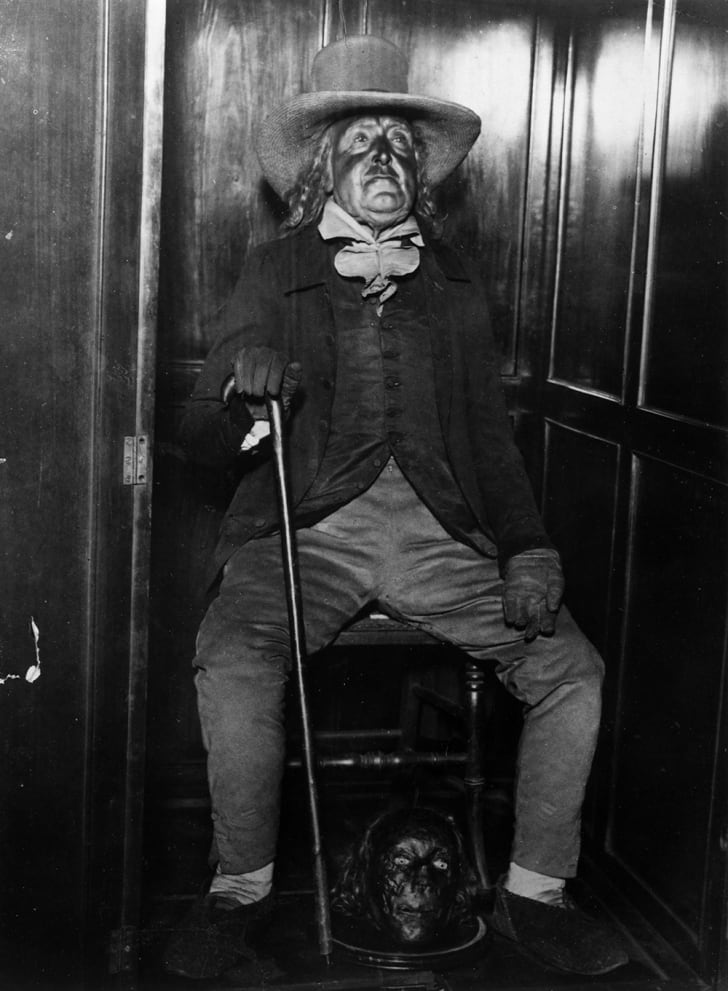 A black-and-white photograph of Jeremy Bentham's auto-icon, with his mummified head