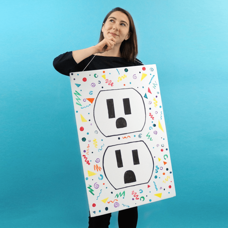 A woman wearing an outlet costume with doodles on it.