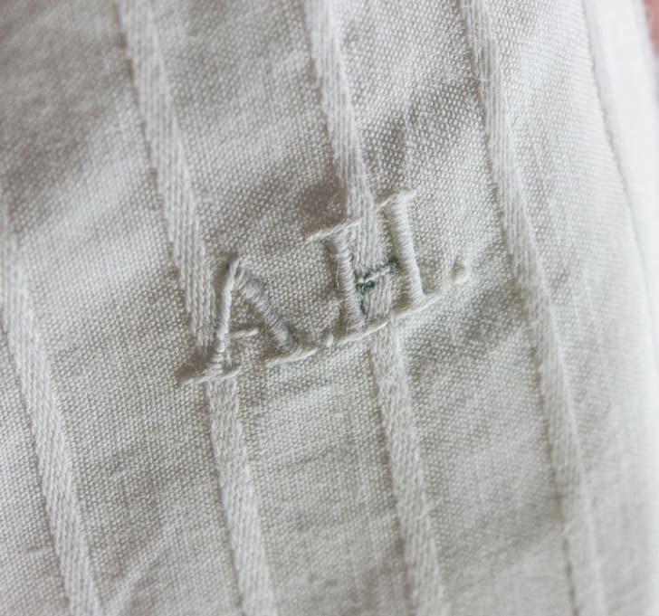 A close up of Hitler's monogrammed initials on his white linen boxers