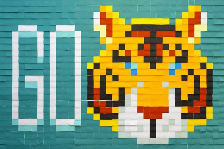 Post-It note mural of sports team.