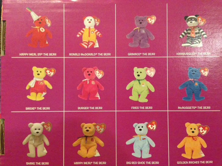 A grid of McDonald's Happy Meal beanie baby toys, including several themed like McDonald's characters.