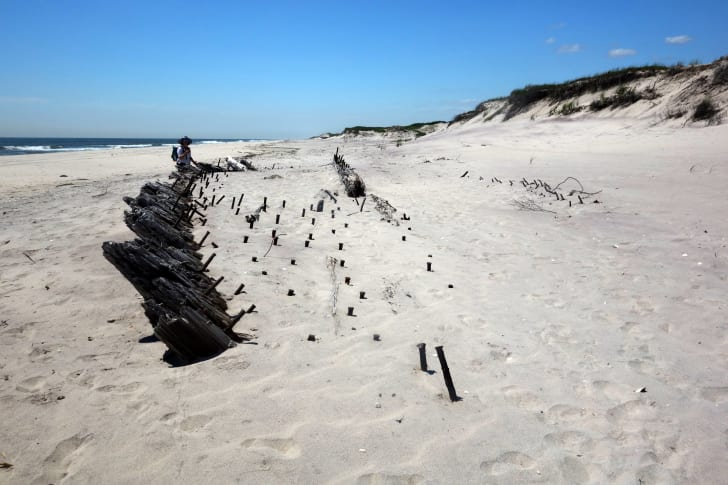 The half-buried shipwreck of the Bessie White on Fire Island, New York