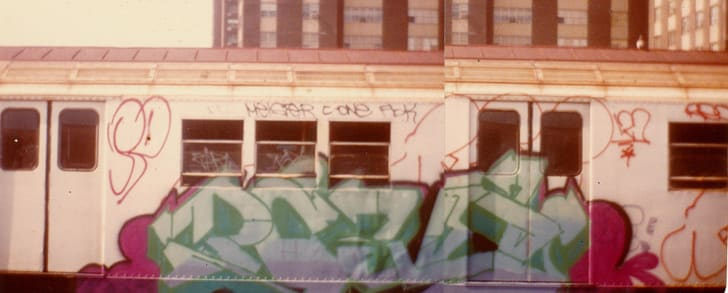 """A subway car reads """"Pove"""" in green letters."""