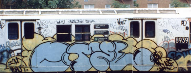"""Blue letters tagged on the exterior of a subway car read """"Comet."""""""