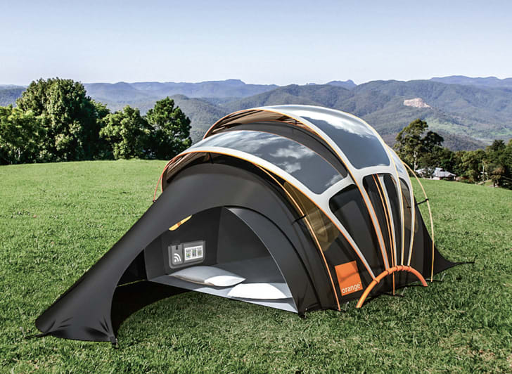 A rendering shows a rounded tent with solar panels on it set up in a grassy field.