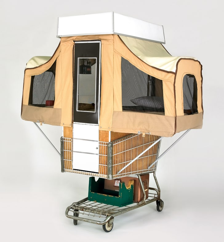 A brown canvas camper pops up from inside a store shopping cart.