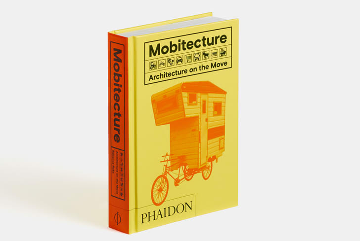 "A yellow book cover reads ""Mobitecture: Architecture on the Move."""