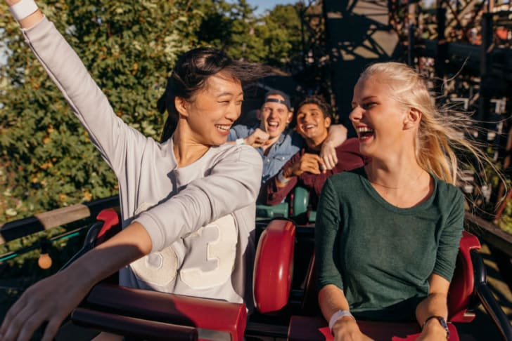 Roller coaster riders enjoy the end of the ride