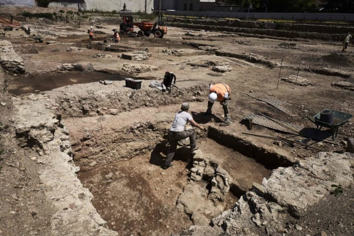 Archaeologist excavating ruins in Vienne, France.