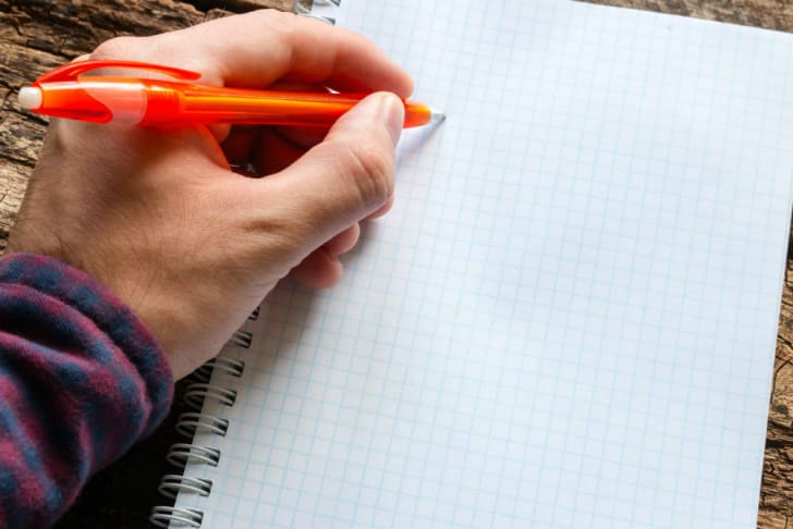 A spiral notebook poses problems for a left-handed writer