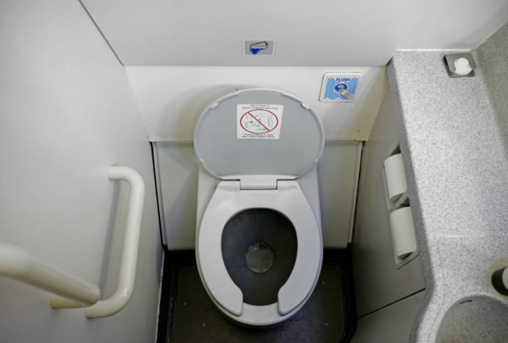 A look at the interior of a cramped airplane bathroom