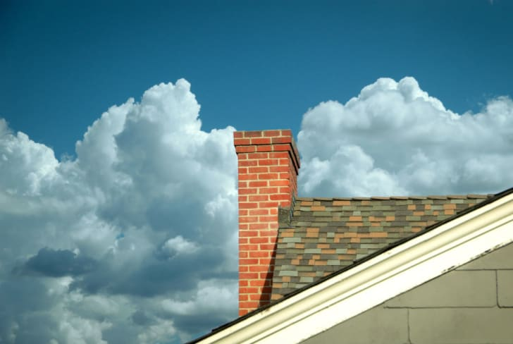 A chimney sits on a rooftop