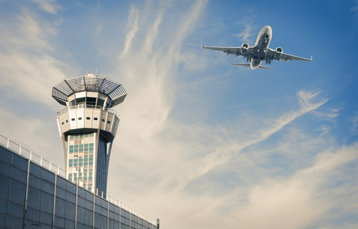 An airplane and an air control tower