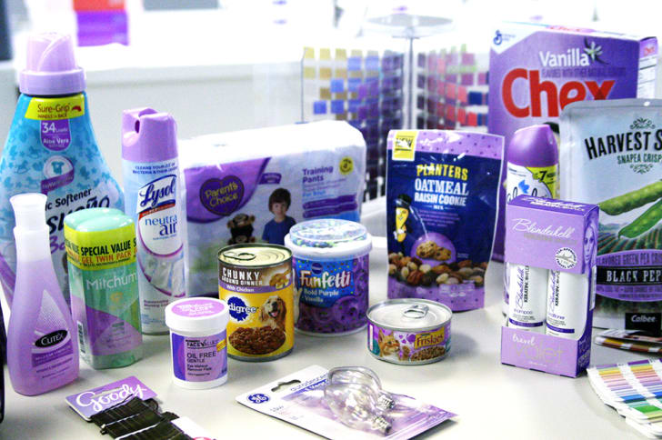 An array of purple packaging sits on a white counter.