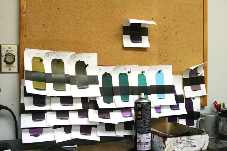 Ink samples posted on a bulletin board