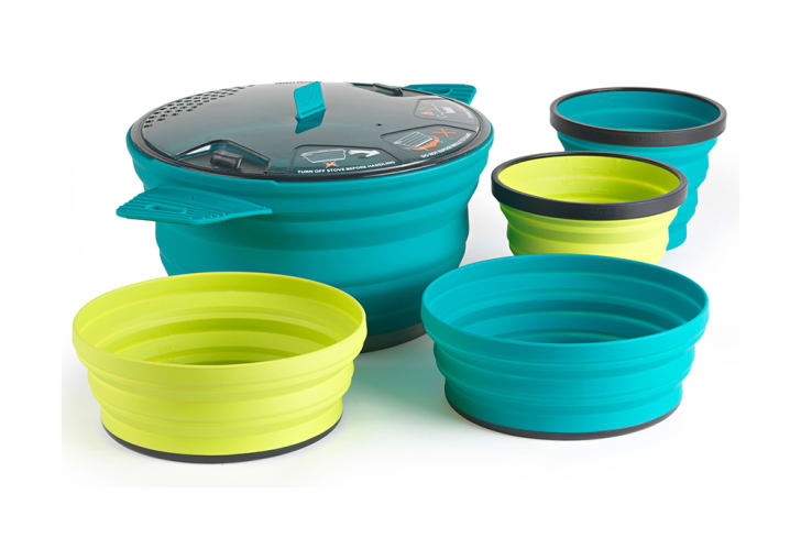A silicone cookware set with a pot, two cups, and two bowls in blue and green