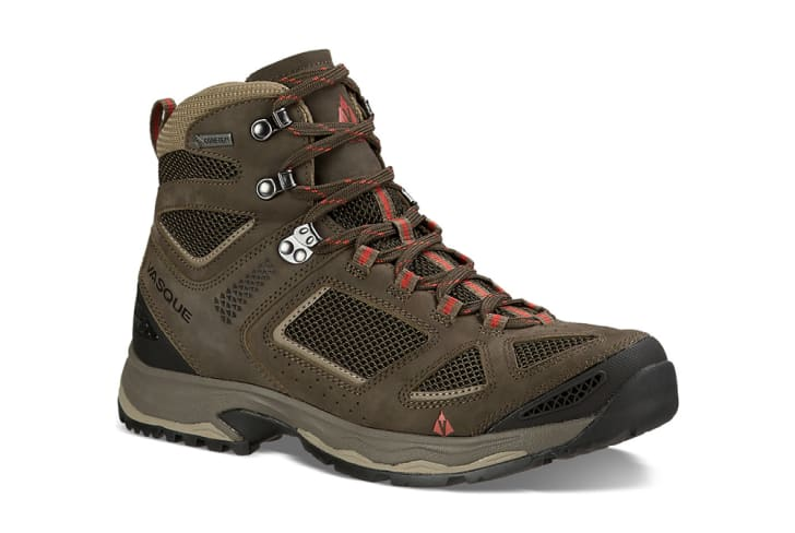 A brown hiking boot seen against a white background.