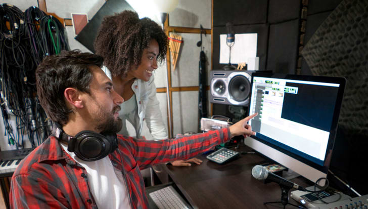 Two professionals working in a sound studio