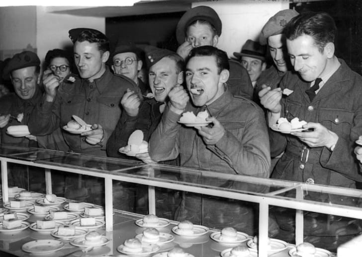 British soldiers are served ice cream during World War II