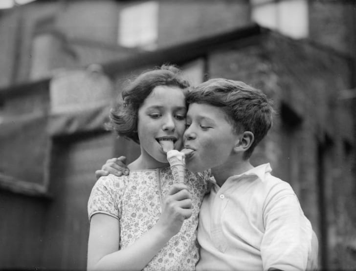 Siblings share an ice cream