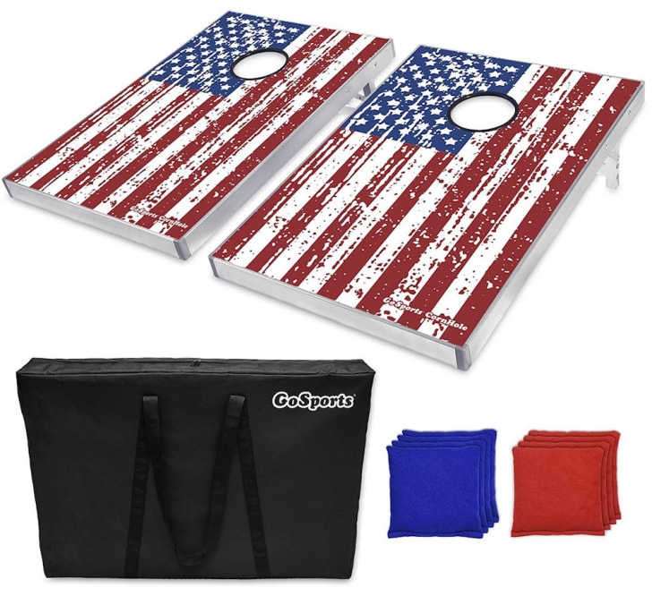 Two American flag cornhole boards with bean bags.