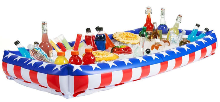 Inflatable American flag cooler filled with ice and drinks.