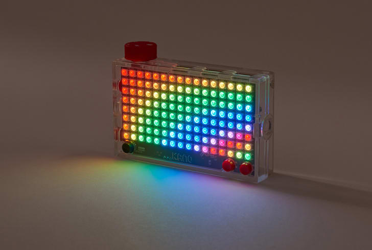 A multi-colored Kano Pixel Kit illuminated in a dark room