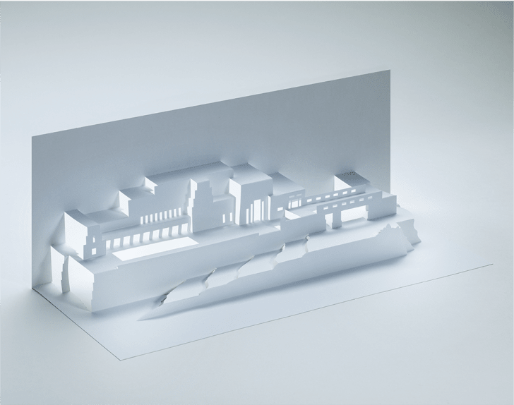 A white paper cut-out of Frank Lloyd Wright's Ennis House design