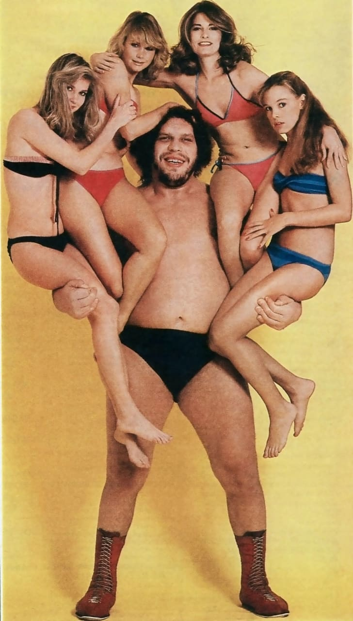 Andre the Giant poses with several models