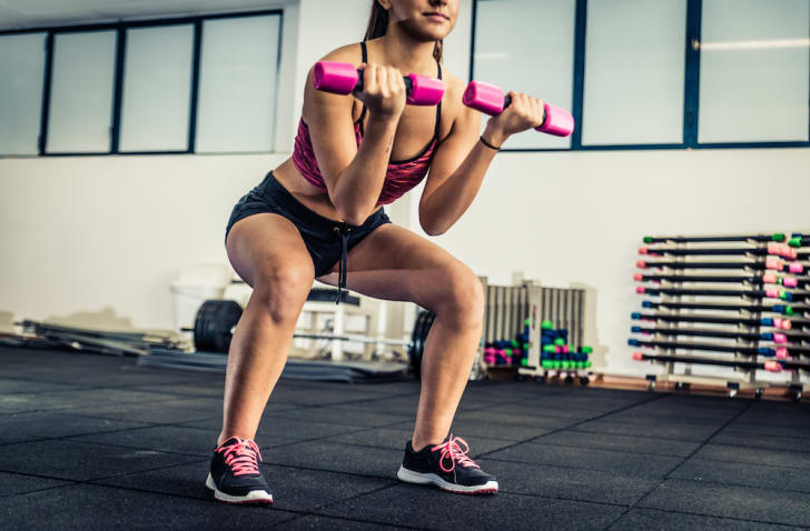 Woman exercising with free weights