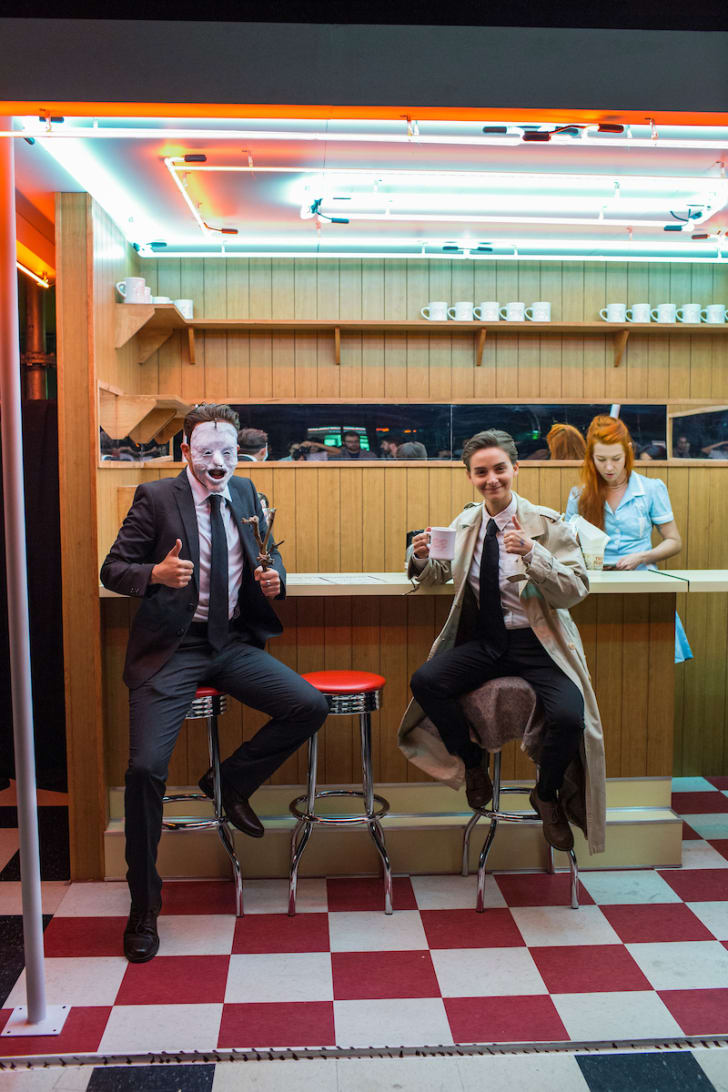 Characters sitting at a recreation of the Twin Peaks Double R diner at a Showtime event in Brooklyn, 2017