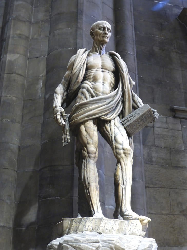 The statue of St. Bartholomew presiding over the Milan Cathedral