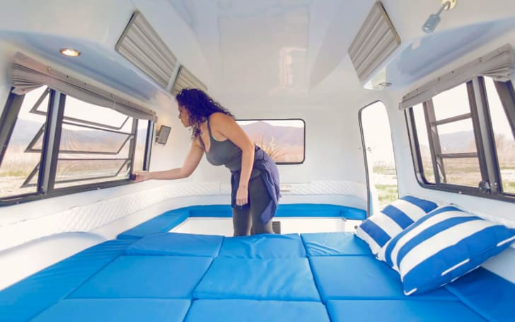 Women inside Happier Camper outfitted with bed attachments.