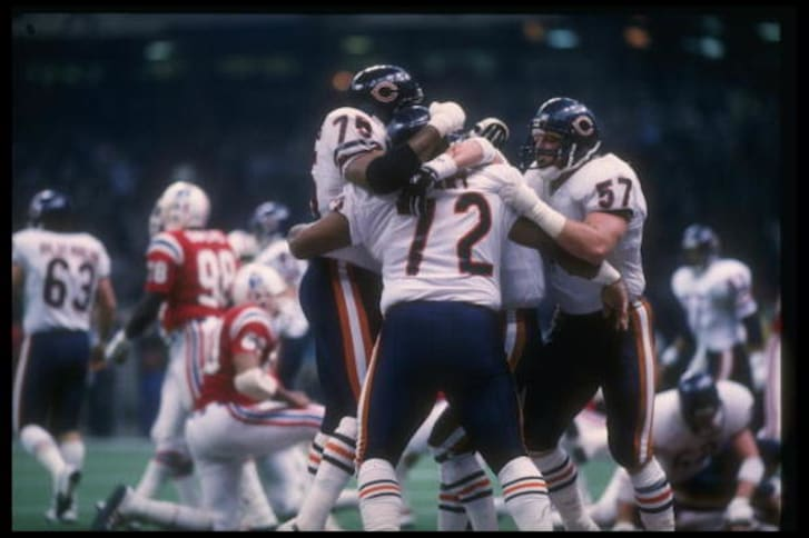 "The Chicago Bears celebrate after William ""The Refrigerator"" Perry scores a touchdown during Super Bowl XX against the New England Patriots."