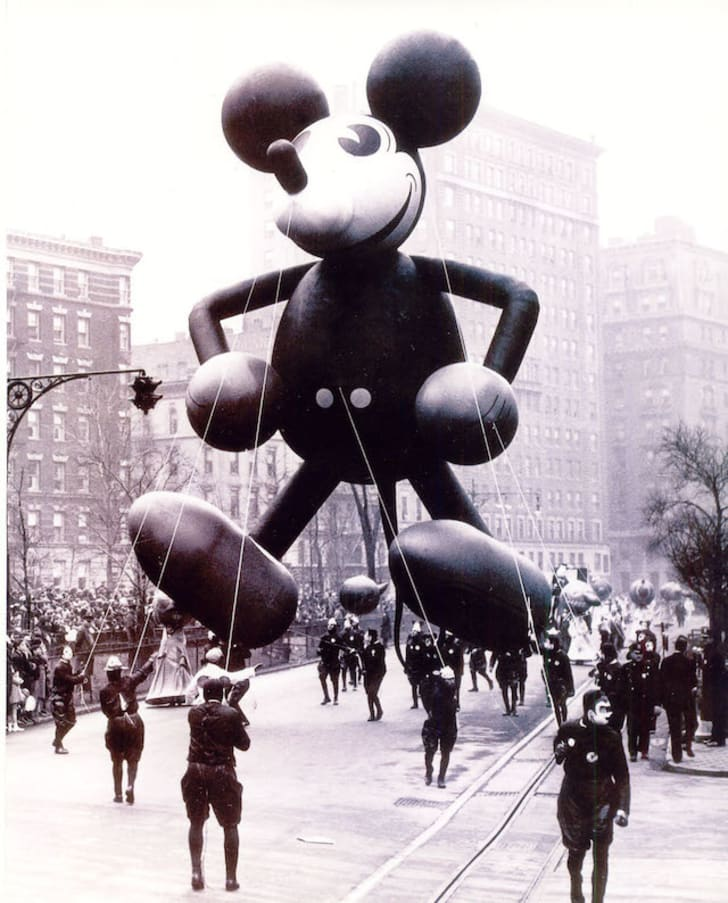 A black-and-white photo of Micky Mouse at an early Macy's Thanksgiving parade