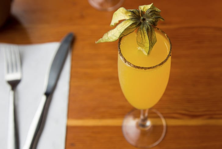 A mimosa cocktail with garnish