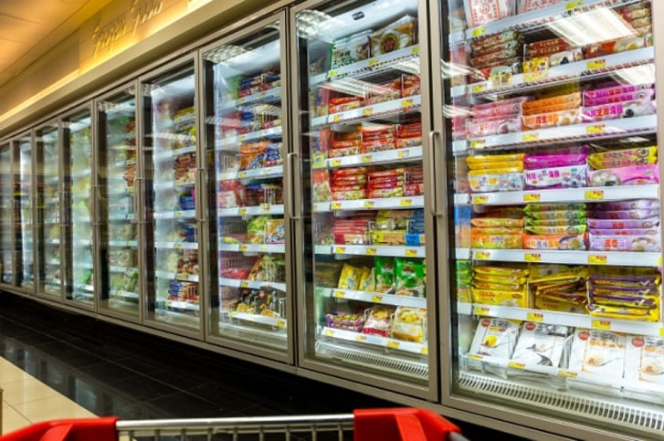 The frozen food aisle of a grocery store
