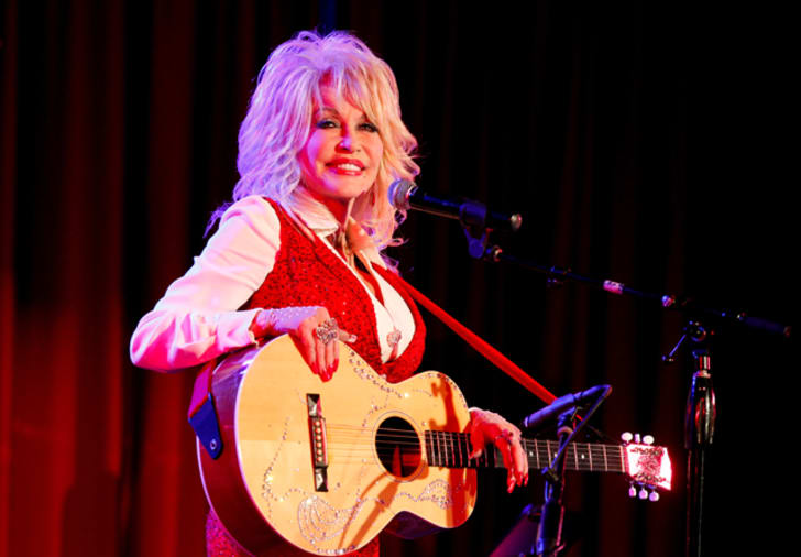 A photo of Dolly Parton on stage
