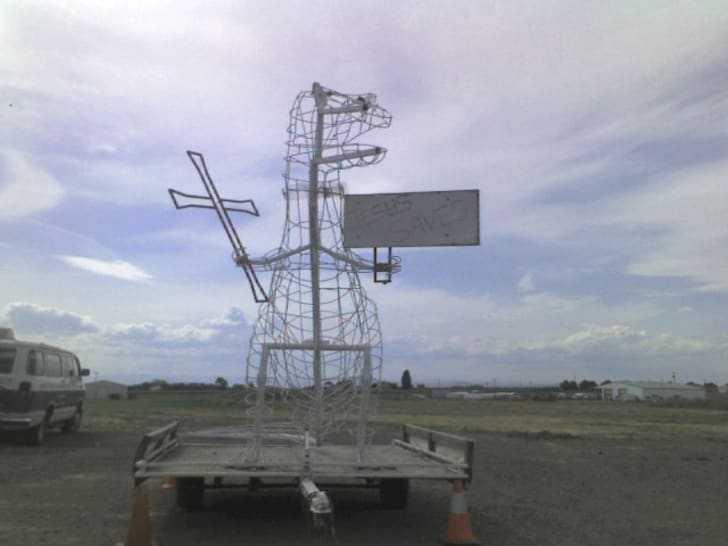 A wire-frame Godzilla model located in front of the Church of God Zillah in Zillah, Washington, USA
