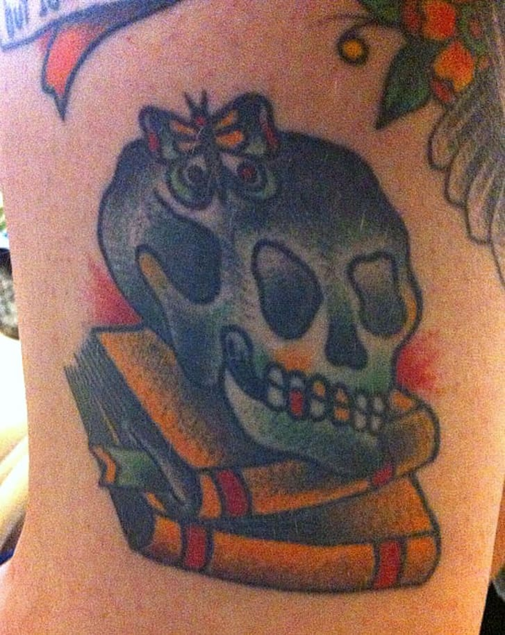 2b6edd6b93888 Another submitter to the Tattoo Lit Tumblr shared this old school style  tattoo depicting a skull atop a pile of books. The tattoo was a celebration  of that ...