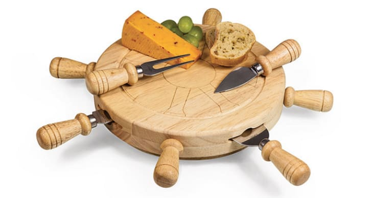 A cheese board shaped like a ship's wheel
