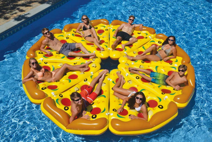 Friends on interlinked pizza slice-shaped pool floats