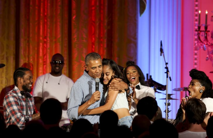 President Barack Obama hugs his daughter Malia Obama at the Fourth of July White House party on July 4, 2016. Maila celebrated her 18th birthday during the party, which featured guests including singers Janelle Monae and Kendrick Lamar.