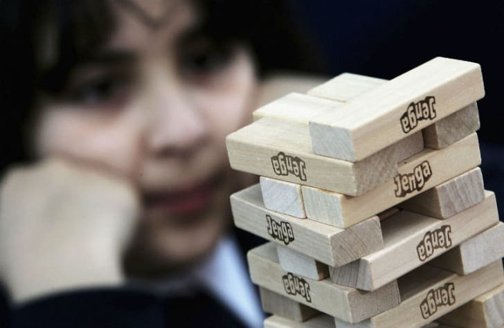 A student attempts to break a Guinness World Record of 30 'Jenga' levels in 11 minutes and 55 seconds in London in 2005