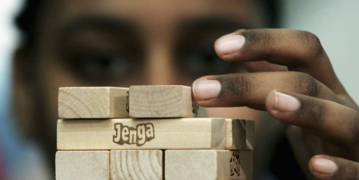 Sabrina Ibrahim works to break a Guinness World Record of 30 levels in 'Jenga' in 11 minutes and 55 seconds in London in 2005