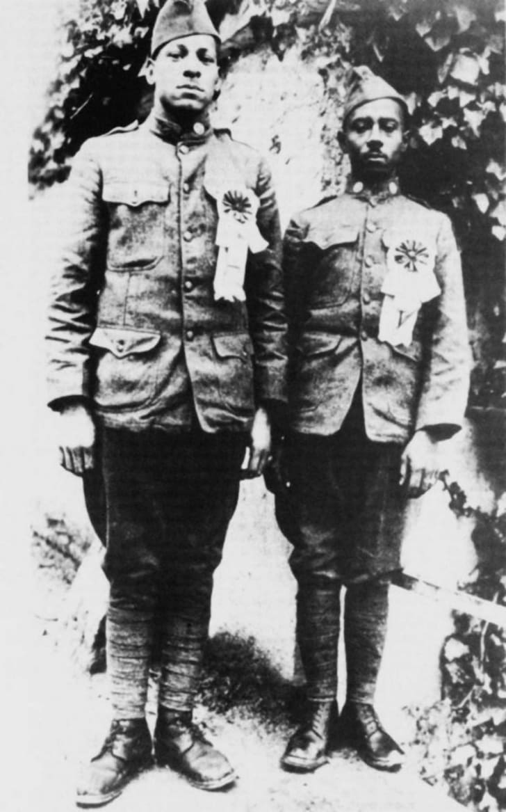 Needham Roberts (L) and William Henry Johnson (R) pose for a photo with their Croix de Guerre medals in 1918